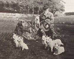 Colonel Malcolm of Poltolloch with his Westies